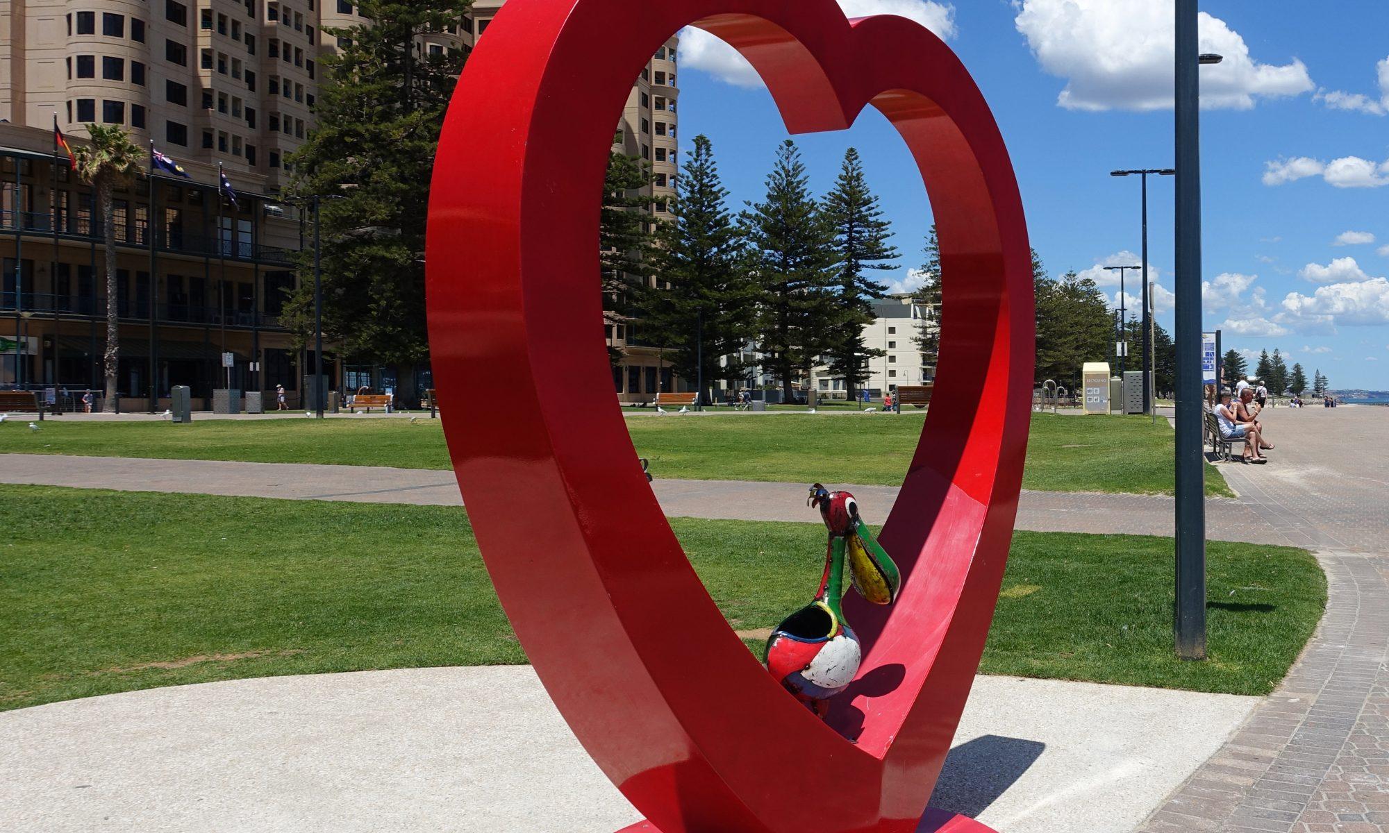 Percival on heart sculpture